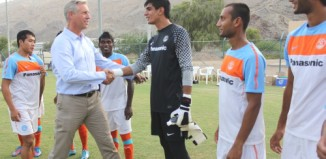 India's U-22 players greet National Coach Wim Koevermans at a practice session in Muscat.
