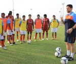 Optimized-Arthur Papas with the boys at the first training session in Muscat.