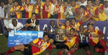 East Bengal players celebrate with the trophy.