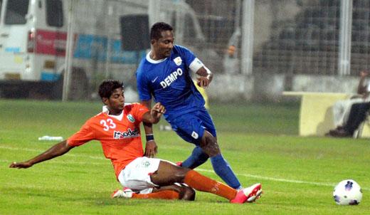 Dempo's Clifford Miranda in action against Sporting Clube de Goa.