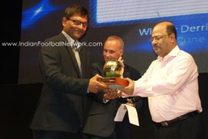 Derrick receiving the best coach award from Subrata Dutta and Joe Morrison
