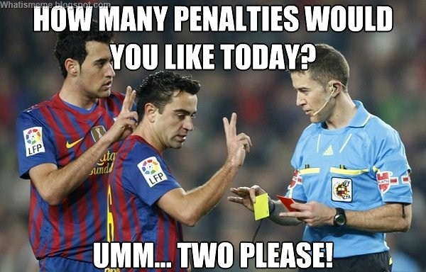 Referee awarding penalty to Barcelona