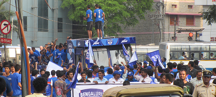 BFC players dancing at the top of the bus
