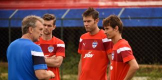 Coach Albert Roca with Cameron Watson, Juan Gonzalez and Alvaro Rubio